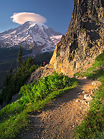 Path with hiker and Mt. Rainier with lenticular cloud. Mt. Rainier National Park, Washington