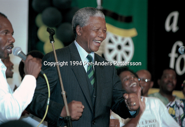 JOHANNESBURG, SOUTH AFRICA - MAY 2: Former South African president Nelson Mandela dances at a victory party held at Carlton Hotel on May 2, 1994 in Johannesburg, South Africa. The historic democratic election was held on April 27, 1994 and Mr. Mandela and his party, the African National Congress, won. Mr. Mandela became the first black democratic elected president in South Africa. He retired from office after one term in June 1999. (Photo by Per-Anders Pettersson).
