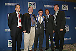 12 January 2007: Nico Colaluca (center) was taken by the Colorado Rapids with the overall #6 pick. He is flanked by team Governor Charlie White (2nd from left) and head coach Fernando Clavijo (2nd from right) and other members of the team's technical staff. The 2007 MLS SuperDraft was held in the Indianapolis Convention Center in Indianapolis, Indiana during the National Soccer Coaches Association of America's annual convention.