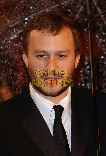 HEATH LEDGER.Arrivals at The Orange British Academy Film Awards, .(BAFTA's) Odeon Leicester Square, London, England,.19 February 2006.bafta baftas umbrella portrait headshot beard.Ref: FIN.www.capitalpictures.com.sales@capitalpictures.com.©Steve Finn/Capital Pictures.