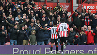 Ollie Watkins celebrates scoring Brentford's third goal in front of the home fans during Brentford vs Queens Park Rangers, Sky Bet EFL Championship Football at Griffin Park on 11th January 2020