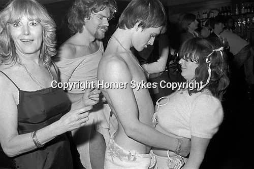 Richard Branson and Mike Oldfield dressed as 'babies' in a fancy dress, Virgin Records company office party at The Venue Victoria London 1978.