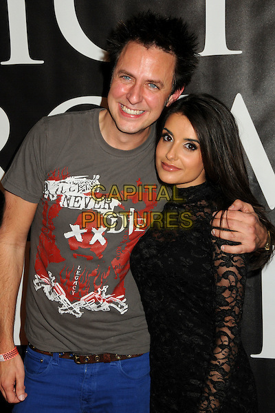"JAMES GUNN & MIKAELA HOOVER.""Hatchet II"" Los Angeles Premiere held at Grauman's Egyptian Theatre, Hollywood, California, USA, .28th September 2010..half length grey gray arm around t-shirt black lace glasses .CAP/ADM/BP.©Byron Purvis/AdMedia/Capital Pictures."