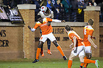 Mark McKenzie (6) of the Wake Forest Demon Deacons heads the ball away from Justin Malou (19) of the Clemson Tigers during first half action at Spry Soccer Stadium on November 8, 2017 in Winston-Salem, North Carolina.  The Demon Deacons defeated the Tigers 2-1.  (Brian Westerholt/Sports On Film)