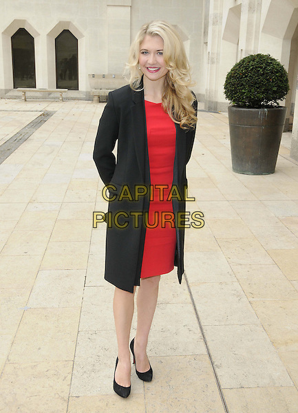 Scarlett Strallen.The Theatre Awards UK 2012, The Guildhall, London, England..October 28th, 2012.full length black jacket coat red dress.CAP/CAN.©Can Nguyen/Capital Pictures.