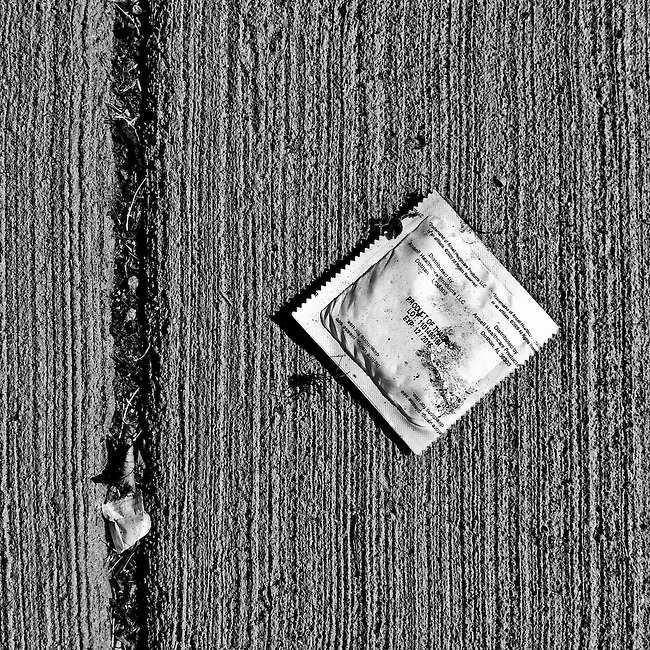 An unopened condom made in Thailand on the sidewalk on K St at near North Capitol St. NW in Washington on May 26, 2011.