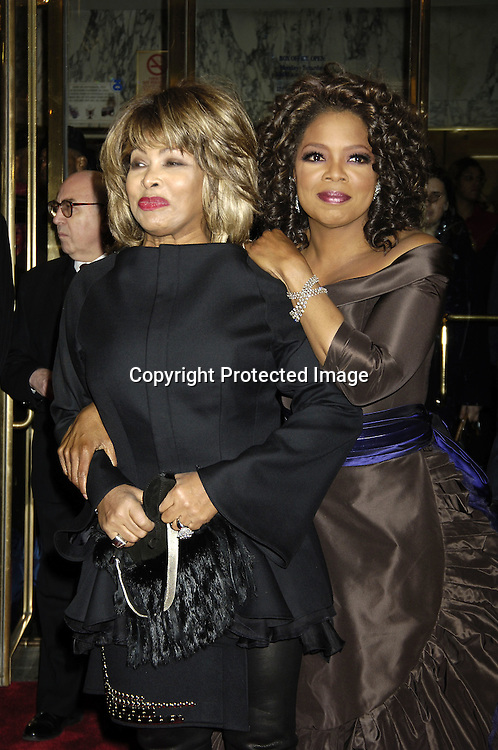 "Tina Turner and Oprah Winfrey ..arriving at the Broadway opening of ""The Color Purple"" ..produced by Oprah Winfrey on December 1, 2005 ..at The Broadway Theatre...Photo by Robin Platzer, Twin Images"