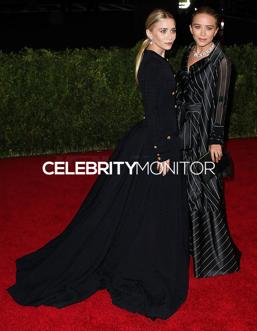 "NEW YORK CITY, NY, USA - MAY 05: Ashley Olsen, Mary-Kate Olsen at the ""Charles James: Beyond Fashion"" Costume Institute Gala held at the Metropolitan Museum of Art on May 5, 2014 in New York City, New York, United States. (Photo by Xavier Collin/Celebrity Monitor)"