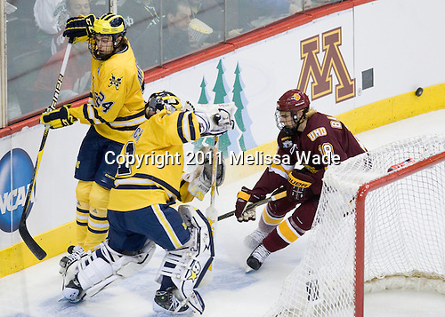 Jon Merrill (Michigan - 24), Shawn Hunwick (Michigan - 31), Joe Basaraba (Duluth - 18) - The University of Minnesota-Duluth Bulldogs defeated the University of Michigan Wolverines 3-2 (OT) to win the 2011 D1 National Championship on Saturday, April 9, 2011, at the Xcel Energy Center in St. Paul, Minnesota.