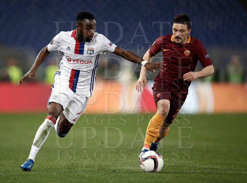 Football Soccer: Europa League Round of 16 second leg, Roma-Lyon, stadio Olimpico, Roma, Italy, March 16,  2017. <br /> Lyon's Maxwel Cornet (l) in action with Roma's Mario Rui (r) during the Europe League football soccer match between Roma and Lyon at the Olympique stadium, March 16,  2017. <br /> Despite losing 2-1, Lyon reach the quarter finals for 5-4 aggregate win.<br /> UPDATE IMAGES PRESS/Isabella Bonotto