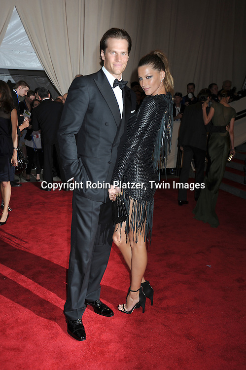 Tom Brady and wife Gisele Bundchen arriving at The Costume Institute Gala Benefit celebrating American Woman: Fashioning a National Identity at The Metropolitan Museum of Art on May 3, 2010 in New York City.