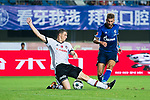 Besiktas Istambul Defender Matej Mitrovic (L) trips up with FC Schalke Forward Guido Burgstaller (R) during the Friendly Football Matches Summer 2017 between FC Schalke 04 Vs Besiktas Istanbul at Zhuhai Sport Center Stadium on July 19, 2017 in Zhuhai, China. Photo by Marcio Rodrigo Machado / Power Sport Images