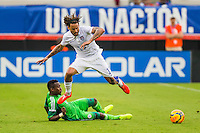 June 07, 2014:   the United States of America midfielder Jermaine Jones (13) leaps over a Nigeria defender during action between the USA Men's National Soccer team and Nigeria at EverBank Field in Jacksonville, Florida.  This is the last match before the USA team leaves for Brazil and the 2014 World Cup Championships. USA defeated Nigeri 2-1.