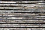 Old weathered bleached wooden boards, light gray grainy wood texture background