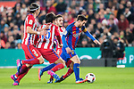 Lionel Andres Messi (r) of FC Barcelona vies for the ball with the Atletico de Madrid's players during their Copa del Rey 2016-17 Semi-final match between FC Barcelona and Atletico de Madrid at the Camp Nou on 07 February 2017 in Barcelona, Spain. Photo by Diego Gonzalez Souto / Power Sport Images