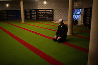 A man worships in the Lyalya-Tulip Mosque in Ufa, Bashkortostan, Russia.  The mosque is the center of Islam in Bashkortostan.