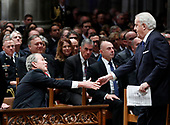 Former Canadian Prime Minister Brian Mulroney shakes hands with former President George W. Bush after Mulroney gave a eulogy at the State Funeral for former President George H.W. Bush at the National Cathedral, Wednesday, Dec. 5, 2018, in Washington. <br /> Credit: Alex Brandon / Pool via CNP