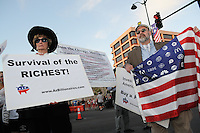 Mesa, Arizona. February 23, 2012 - As Republican candidates debated in the Mesa Arts Center, protesters including undocumented students, tea partiers, occupy movement members and Syrian president opponents, shouted slogans and held up signs and placards outside. In this photograph, members of the group Arizona Billionaires for Wealthcare demonstrate outside the presidential debate in Mesa, Arizona. The group is a grassroots network of health care activists who use sarcasm to seek changes in the healthcare system. Photo by Eduardo Barraza © 2012
