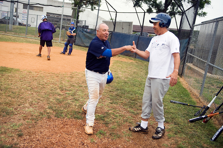 UNITED STATES - JUNE 16:  Rep. Joe Baca, D-Calif., left, greets Rep. Lacy Clay, D-Mo., during the democratic team baseball practice at Brentwood Park in Northeast.  (Photo By Tom Williams/Roll Call)