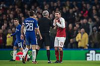 Shkodran Mustafi of Arsenal protests his innocence to Referee Martin Atkinson during the Carabao Cup semi final 1st leg match between Chelsea and Arsenal at Stamford Bridge, London, England on 10 January 2018. Photo by Andy Rowland.