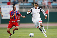 New England Revolution forward Khano Smith (18) and Crystal Palace defender Paul Robson (3). The New England Revolution (MLS) defeated Crystal Palace FC USA of Baltimore (USL2) 5-3 in penalty kicks after finishing regulation and overtime tied at 1-1 during a Lamar Hunt US Open Cup quarterfinal match at Veterans Stadium in New Britain, CT, on July 8, 2008.