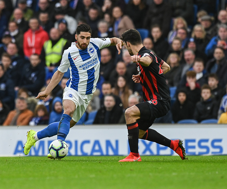 Brighton & Hove Albion's Alireza Jahanbakhsh (left) under pressure from Huddersfield Town's Christopher Schindler (right) <br /> <br /> Photographer David Horton/CameraSport<br /> <br /> The Premier League - Brighton and Hove Albion v Huddersfield Town - Saturday 2nd March 2019 - The Amex Stadium - Brighton<br /> <br /> World Copyright © 2019 CameraSport. All rights reserved. 43 Linden Ave. Countesthorpe. Leicester. England. LE8 5PG - Tel: +44 (0) 116 277 4147 - admin@camerasport.com - www.camerasport.com