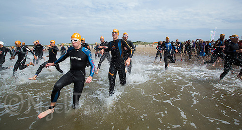 13 JUL 2013 - DEN HAAG, NED - Competitors run into the water at the start of the 2013 ITU Elite Men's and under 23 Men's Cross Triathlon World Championships (PHOTO COPYRIGHT © 2013 NIGEL FARROW, ALL RIGHTS RESERVED)