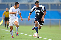 10 September 2011:  FIU's Colby Burdette (2) moves the ball upfield while being pursued by Stetson's Raffaele Centofanti (6) in the first half as the FIU Golden Panthers defeated the Stetson University Hatters, 3-2 in the second overtime period, at University Park Stadium in Miami, Florida.