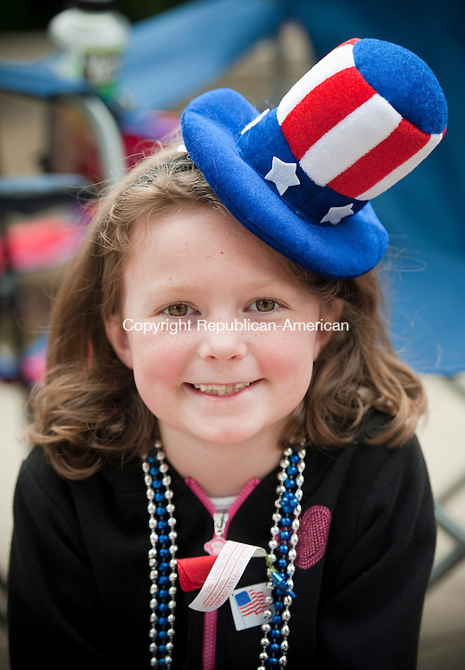 NAUGATUCK, CT--052515JS12-Mackenzie Scully, 7, wears a festive hat as se watches the annual Naugatuck Memorial Day Parade on Monday. <br /> Jim Shannon Republican-American