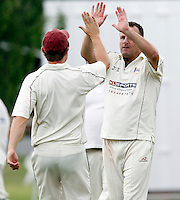 Craig Gourlay (L) high fives Tony Duckett of Highgate after he dismissed Jack Atchinson of North London during the Middlesex County Cricket League game between Highgate and North London at Park Road, Crouch End on Sat July 31, 2010.