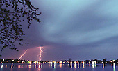 Electrifying:  Lightning bolts strike over and around Lake Orion Monday night as a storm rages through town.  High winds, pelting rain and crackling thunder stayed around for hours, inconveniencing some by knocking out power, but entertaining others who see nature's beauty even through a stormy night.