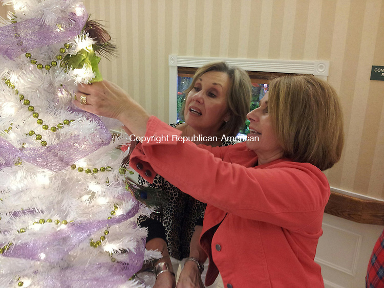 TORRINGTON, CT- 23 November 2013- 112313BJ01-- Karen Bentley, retired Torringford School teacher, and Judith Theeb, Southwest School principal, decorate a tree for the 12th annual Festival of Trees to benefit LARC. Bentley and Theeb are decorating a tree for the Torrington chapter of Alpha Delta Kappa, a sorority for educators. The pair decoraated the tree along with Carol Grigos, who is a teacher at Southwest School. Bruno Matarazzo Jr. Republican-American