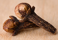 Macro close-up of two whole clove on a wood background