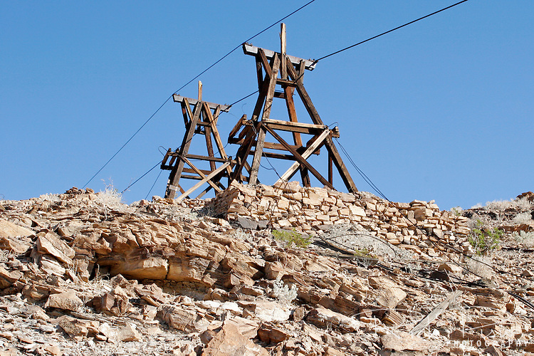 Abandoned tram towers at the Keane Wonder Mine in Death Valley National Park. The Keane Wonder mine was one of the two largest producing gold mines in the Death Valley area. The total production of the mine during its operation was estimated at $1,100,000. Of that amount, $625,000-$682,000 worth of gold was taken from the mine between 1907-1911.