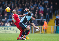 Nigel Atangana of Leyton Orient fouls Sam Wood of Wycombe Wanderers during the Sky Bet League 2 match between Wycombe Wanderers and Leyton Orient at Adams Park, High Wycombe, England on 23 January 2016. Photo by Andy Rowland / PRiME Media Images.