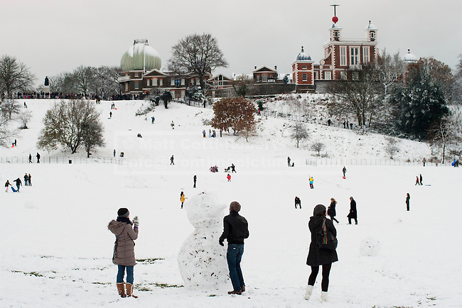 Despite the country coming to a near standstill, people make the most of a snowy Greenwich Park by making snowmen and sledging down the hill below the Royal Observatory.