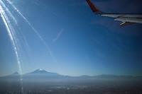 """Armenia. Yerevan. Aeroflot plane on take off above  Yerevan. View on the Ararat Mountain which is a snow-capped and dormant compound volcano in the extreme east of Turkey. It consists of two major volcanic cones: Greater Ararat and Little Ararat. Greater Ararat is the highest peak in Turkey and the Armenian Highland with an elevation of 5,137 m; Little Ararat's elevation is 3,896 m. The Ararat massif is about 35 km wide at ground base. The """"mountains of Ararat"""" have been widely accepted in Christianity as the resting place of Noah's Ark, despite contention that Genesis 8:4 does not refer specifically to Mt. Ararat. It is the principal national symbol of Armenia and has been considered a sacred mountain by Armenians. It is featured prominently in Armenian literature and art and is an icon for Armenian irredentism. PJSC Aeroflot – Russian Airlines, commonly known as Aeroflot is the flag carrier and largest airline of the Russian Federation. The air carrier is an open joint stock company that operates both domestic and international passenger and services.Yerevan, sometimes spelled Erevan, is the capital and largest city of Armenia. 13.10.2019 © 2019 Didier Ruef"""