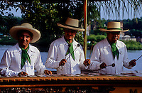 three mexican men in nice dress , with hats playing syllophone music