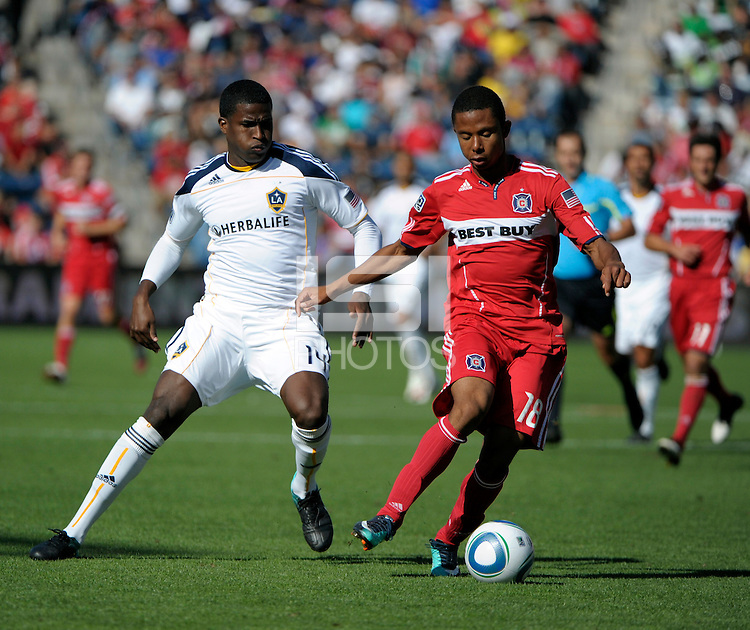 Chicago midfielder Mike Banner (18) plays the ball in front of LA Galaxy forward Edson Buddle (14).  The LA Galaxy tied the Chicago Fire 1-1 at Toyota Park in Bridgeview, IL on September 4, 2010