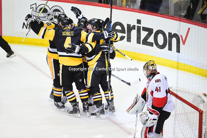 May 25, 2017: Pittsburgh Penguins left wing Chris Kunitz (14) along with teammates celebrate a goal against Ottawa Senators goalie Craig Anderson (41) during game seven of the National Hockey League Eastern Conference Finals between the Ottawa Senators and the Pittsburgh Penguins, held at PPG Paints Arena, in Pittsburgh, PA. The Pittsburgh Penguins defeat the Ottawa Senators 3-2 in double overtime to win the NHL Eastern Conference Championship and advance to face the Nashville Predators in the Stanley Cup Finals.  Eric Canha/CSM
