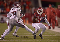 NWA Democrat-Gazette/BEN GOFF @NWABENGOFF<br /> Jared Cornelius, Arkansas wide receiver, attempts to evade Brandon Bryant (20) and Zach Jackson, Mississippi State defenders, in the first quarter on Saturday Nov. 21, 2015 during the game in Razorback Stadium in Fayetteville.
