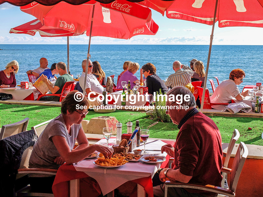 Guests dining at a chiringuito, open-air beach restaurant, specialising in fish especially sardines and seabass for clients in Marbella, Malaga, Spain, Espana. Big attraction is that the fish are cooked in the open-air over a wood-burning grill. 201412150214<br /> <br /> Copyright Image from Victor Patterson, 54 Dorchester Park, Belfast, UK, BT9 6RJ<br /> <br /> t1: +44 28 9066 1296<br /> t2: +44 28 9002 2446<br /> m: +44 7802 353836<br /> <br /> e1: victorpatterson@me.com<br /> e2: victorpatterson@gmail.com<br /> <br /> www.victorpatterson.com<br /> <br /> IMPORTANT: Please see my Terms and Conditions of Use at www.victorpatterson.com