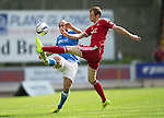 St Johnstone v Aberdeen...23.08.14  SPFL<br /> Mark Reynolds and Lee Croft<br /> Picture by Graeme Hart.<br /> Copyright Perthshire Picture Agency<br /> Tel: 01738 623350  Mobile: 07990 594431