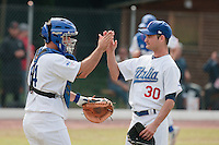 30 july 2010: Carlos Pezzullo (right) is congratulated by Juan Angrisano during Italy 9-2 win over France, in day 6 of the 2010 European Championship Seniors, at TV Cannstatt ballpark, in Stuttgart, Germany.