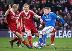 Aberdeen v St Johnstone....01.02.14   League Cup Semi-Final<br /> David Wotherspoon's shot is blocked by Andrew Considine<br /> Picture by Graeme Hart.<br /> Copyright Perthshire Picture Agency<br /> Tel: 01738 623350  Mobile: 07990 594431