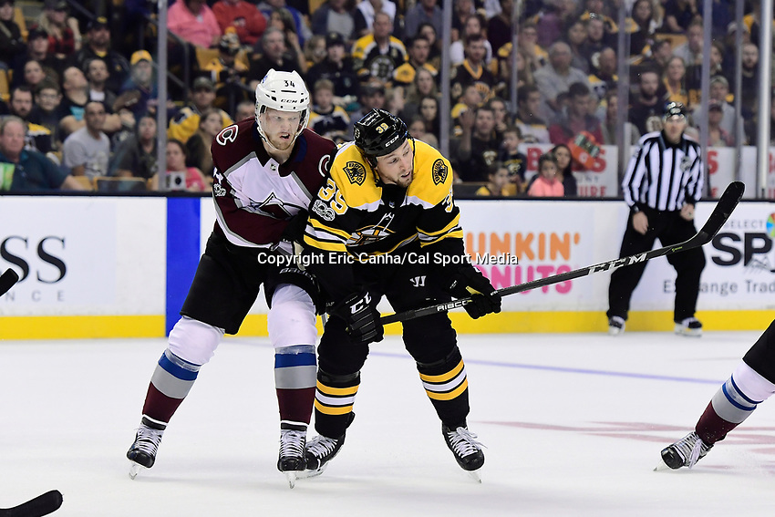 October 9, 2017: Colorado Avalanche center Carl Soderberg (34) and Boston Bruins left wing Matt Beleskey (39) in game action during the NHL game between the Colorado Avalanche and the Boston Bruins held at TD Garden, in Boston, Mass. Colorado defeats Boston 4-0. Eric Canha/CSM