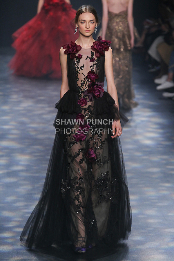 Model Daga walks runway in a black and amethyst A-lin gown with black floral embroidery, laser-cut amethyst ombré flowers and pleated tulle skirt, from the Marchesa Fall 2016 collection by Georgina Chapman and Keren Craig, presented at NYFW: The Shows Fall 2016, during New York Fashion Week Fall 2016.