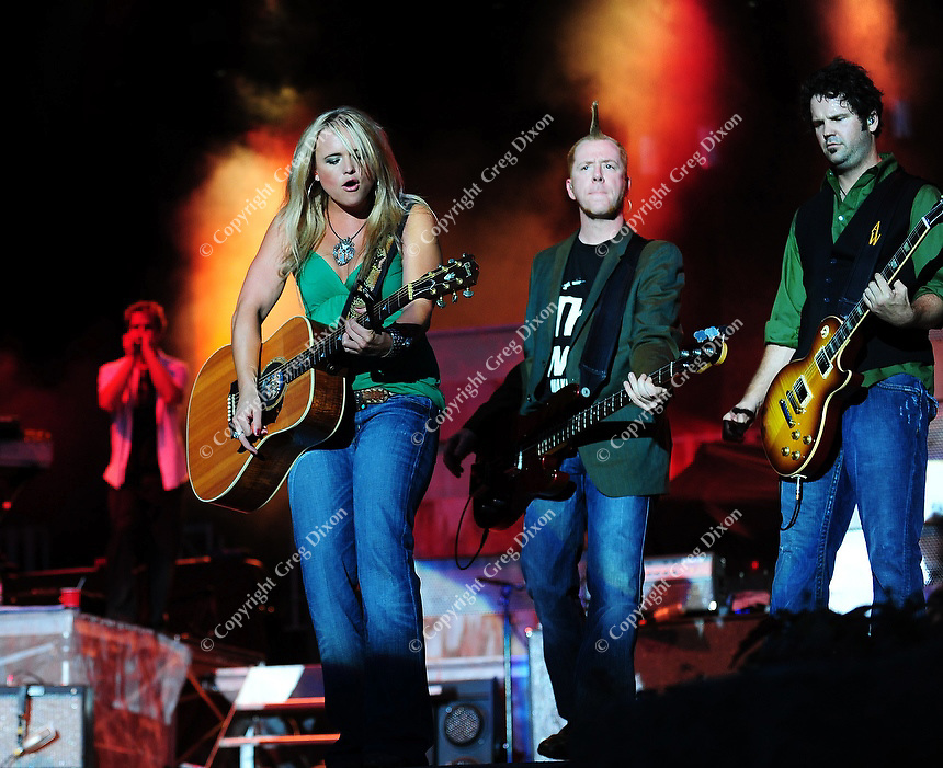 Miranda Lambert sings with her band during a concert at Country Thunder USA in Twin Lakes, Wisconsin on 8/17/08