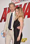 HOLLYWOOD, CA - JUNE 25: Michelle Pfeiffer (R) and David E. Kelley arrive at the Premiere Of Disney And Marvel's 'Ant-Man And The Wasp' at the El Capitan Theatre on June 25, 2018 in Hollywood, California.