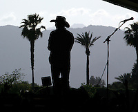 COACHELLA,CA - APRIL 25,2009: Kevin Costner looks out over the Stagecoach scene after Kevin Costner & Modern West performance at Stagecoach country music festival in Indio April 25, 2009.